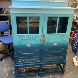 THE BLUE LAGOON,… DISPLAY CABINET.